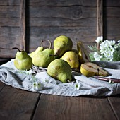 Pears on a rustic linen cloth