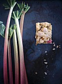 Vegan rhubarb crumb cake with fresh rhubarb sticks