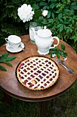 Sweet cherry tart served in the garden