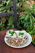 Scrabled eggs with wild mushrooms, served with two slices of baguette