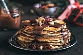 Sweet chocolate sauce on homemade pancakes in the plate