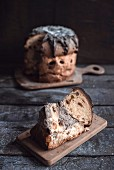 Slice of panettone cake on wooden board