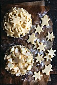 Apple pie with Christmas decoration prepared for baking