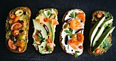 Diet sandwiches with salmon and avocado on dark background