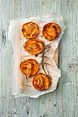 Baked sweet potato slices with onions and rosemary