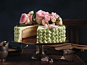 Raspberry and pistachio cake, sliced