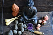 Colourful vegetables and a Buddha statue