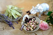 Dried lime blossoms, lavender, dried hibiscus blossoms, and rose buds