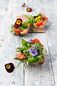 Open sandwiches topped with a spring salad