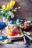 Roast beef with an almond and egg white crust and potatoes for Easter