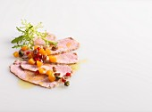 Veal carpaccio on a white background