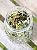 Hand-picked lemon balm (Melissa officinalis) tea leaves in a jar