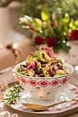 Grilled brussels sprouts with pickled red onion and chestnut crumble