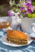 Honey baklava with pistachios, nuts and almonds on a table outdoors