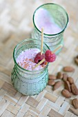 A smoothie with almond milk and raspberries