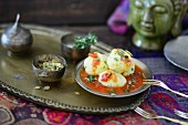 Polenta dumplings with tomato and pumpkin seed salsa