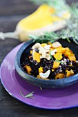Black risotto with butternut squash and cashew nuts
