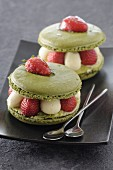 Pistachio macarons filled with cream and strawberries