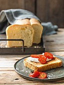 Homemade buttered toast with fresh cheese and tomatoes