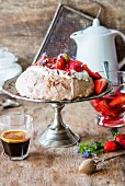 Chocolate pavlova with cream and strawberries