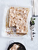 An aronia berry cake topped with meringue