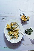 Trout pieces with potato crisps and crispy sage