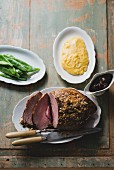 Veal roast with a juniper crust, beans and polenta