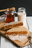Honey wafer biscuits on a chopping board
