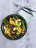 A kale salad with avocado, orange and dates - 'Super Green Hero'