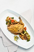 A poached guinea fowl breast with sweet potato and vegetables