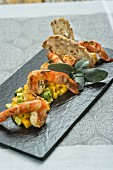 King prawns fried in sage oil with an avocado and mango salad