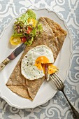 A savoury crepe with a fried egg