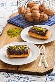 Doughnuts with a chocolate glaze and crushed pistachios