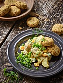 Falafel biscuits with salsa and a cashew and potato salad