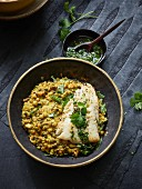 Lentil curry with a fried cod fillet