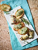 Aubergine rolls and crostini with shrimp tartare