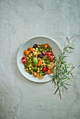 Lupine seeds with tarragon pesto and tomatoes