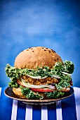 A burger with curly kale
