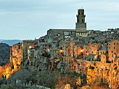View of Pitigliano near Grosseto and the cathedral of Santi Pietro e Paolo in Tuscany, Italy