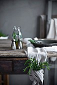 Rosemary wrapped in a linen cloth on a rustic table