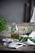 Rosemary infusion in a glass on a rustic wooden table