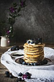 Ricotta pancakes stacked on a rustic background