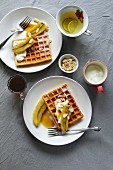 Waffles with caramelized bananas, yogurt and toasted almond flakes