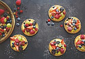 Tartlets with pistachio and rosemary cream and marinated summer berries