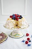 Pavlova with fresh berries, sliced