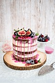 Rustic drip cake with fresh fruit