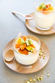 Panna cotta with exotic fruits, honey and pistachios