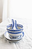 Blue and white Chinese dinner bowls and spoons
