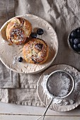 Orange brioche with chocolate, powdered sugar, and blueberries