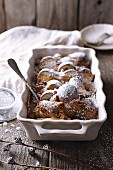 Milk bread pudding with gingerbread spices in a baking dish